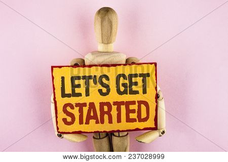 Conceptual Hand Writing Showing Lets Get Started. Business Photo Text Beginning Time Motivational Qu