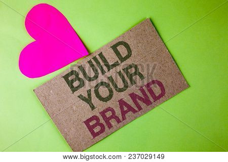 Conceptual Hand Writing Showing Build Your Brand. Business Photo Text Create Your Own Logo Slogan Mo