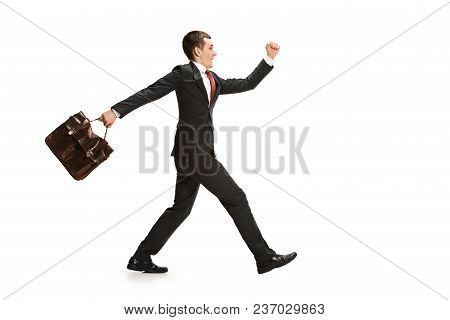 Funny Cheerful Businessman Going Over White Studio Background. Happy Young Man In Suit. Business, Ca