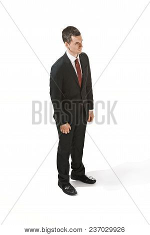 Three-quarter Portrait Of Businessman With Serious Face. Confident Professional With Piercing Lookin