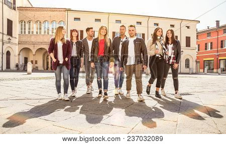 Group Of Best Friends Walking And Talking In City Center - Tourist Guys And Girls Having Fun Around
