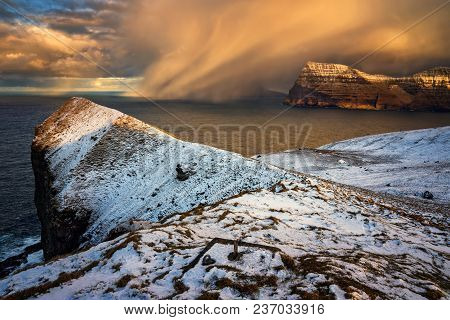 Snowstorm Over Kunoy Island In Sunset, Faroe Islands