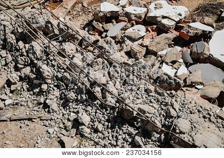 Debris Of A Demolished Wall, Demolition Junk, Steel Structure, Broken Concrete And Pieces Of Masonry