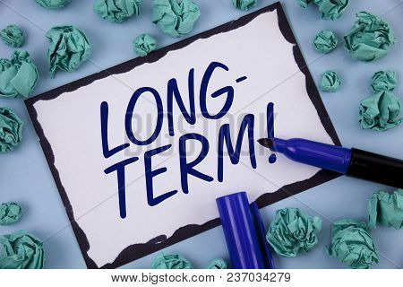 Writing Note Showing  Long-term Motivational Call. Business Photo Showcasing Occurring Over Large Pe