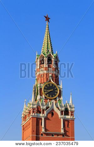 Spasskaya Tower Of The Moscow Kremlin Against The Blue Sky In A Sunny Morning
