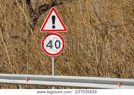 Road Signs Background Of Bushes Danger Ahead And Speed Limit 40