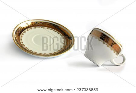Antique Porcelain Cup And Saucer With Shadows On White Background