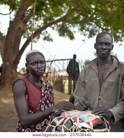 JUBA, SOUTH SUDAN-JUNE 22, 2012: Portrait of unidentified Mundari tribespeople north of Juba, South Sudan, in this illustrative editorial.