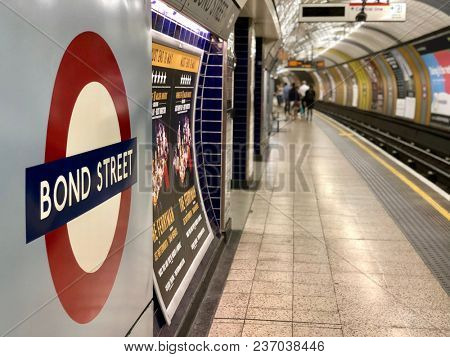 BOND STREET, LONDON - APRIL 20, 2018: Passengers down the platform at Bond Street Jubilee Line Underground station in London, UK.