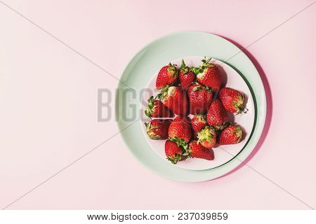 Fresh Strawberries On Turquoise Plate Over Pink Pastel Pin-up Background. Copy Space. Top View