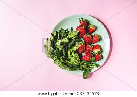 Fresh Strawberries And Bunch Of Mint On Turquoise Plate Over Pink Pastel Pin-up Background. Copy Spa