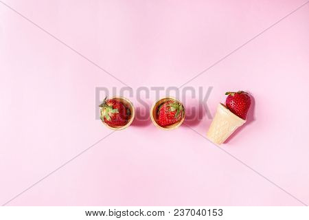 Fresh Strawberries In Waffle Cups Over Pink Pastel Pin-up Background. Copy Space. Top View
