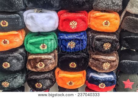 Caps With A Cockade And Stars In Moscow On Arbat Street. Soviet Symbols.