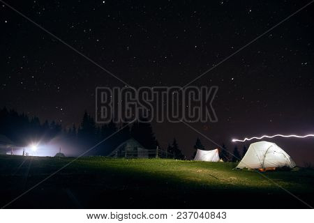 Camping Under The Stars At Night In Mountains Illuminated Tents Carpathians