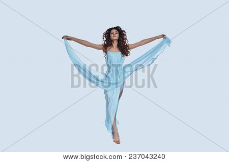 Perfect Beauty. Full Length Studio Shot Of Attractive Young Woman In Elegant Dress Gesturing While H