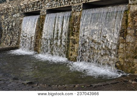 Mineral Spring. Stream Of Floating Water Like Spa. Curative Water In The Resort. Waterfalls In Summe
