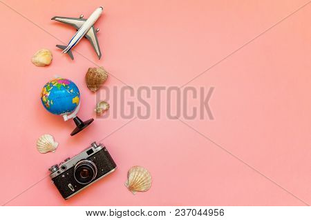 Flat Lay With Toy Plane, Vintage Film Photo Camera, Globe And Shell On Pink Colourful Pastel Trendy