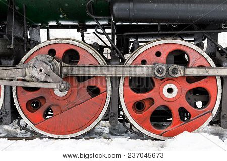 Red Wheel And Detail Of Mechanism A Vintage Russian Steam Train Locomotive.
