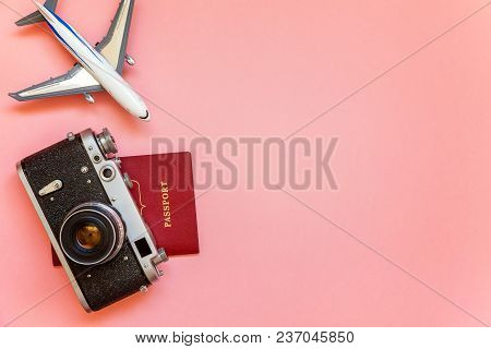 Flat Lay With Toy Plane, Vintage Camera And Passport On Pink Colourful Pastel Trendy Modern Fashion