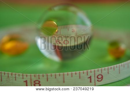 The Magical Crystal Ball Represents The Magical Number Of Waist. Green Background, Health Care, Diet