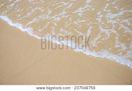 Sea Wave And Sand Beach Photo For Background. Sunny Beach Sand With Sea Wave. White Sand Of Oceanic