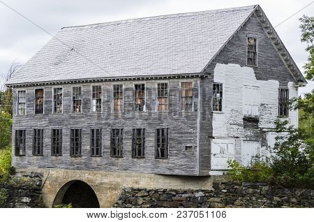 Milo, Maine, Usa - September 28, 2011: Dilapidated Remains Of  Old Spool Factory On Sebec River In M