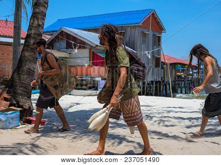 Koh Rong Island, Cambodia - 08 April 2018: Hippie Men On White Sand Beach. Young Men With Dradlock H