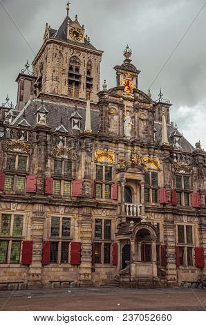 Market Square And Gothic City Hall Building Facade Richly Decorated On Cloudy Day In Delft. Calm And