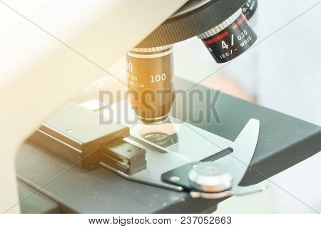 Equipment for research experiments in science laboratory, Microscopy and empty vacuum blood tube,microscope in medical laboratory,Scientists are experimenting in labs poster
