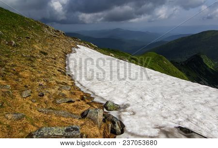 Spring In The Carpathian Mountains. Snow On Tops. Ukraine.