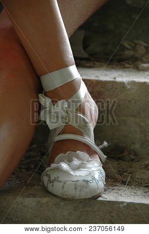 Ballerina. Urban. Ballet dances. Ballerina's feet.  Ballet shoes