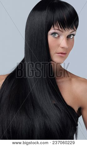 woman close-up isolated on a gray background