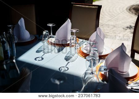 Served For A Banquet Catering Table With Wine Glasses And Plates For Food