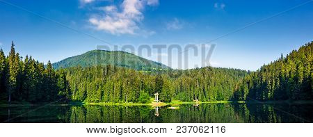 Panorama Of Synevyr Lake On Summer Morning. Gorgeous Scenery With Spruce Forest Reflecting On A Wate