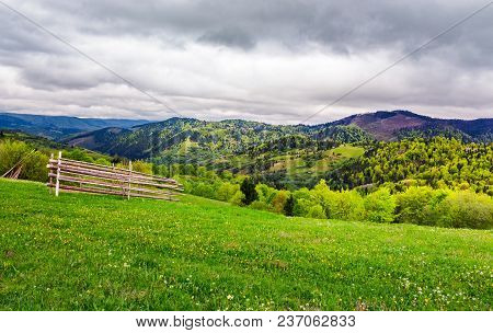 Lovely Rural Scenery Of Carpathians. Beautiful Landscape With Grassy Rural Fields On Hills In Spring