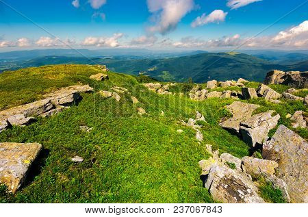 Boulders On Grassy Hill In Summer. Lovely Nature Scenery Under The Cloudy Sky In Carpathian Mountain