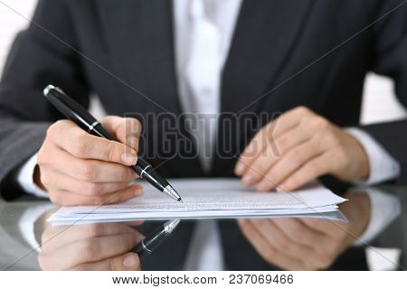 Close-up Of Female Hands With Pen Over Document,  Business Concept.