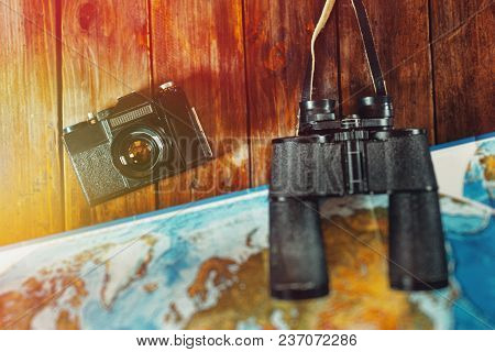Adventure Journey Travel Scout Journey Concept. Vintage Film Camera, Map And Binoculars On Wooden Ta