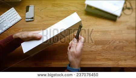 Paris, France - Apr 12 2018: Pov Man Unboxing Using Cutter Knife - Unpacking Latest Apple Watch Seri