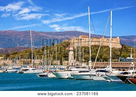 Luxury yachts moored in port of Antibes - famous resort on French Riviera.