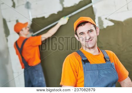 plaster service. portrait of male plasterer