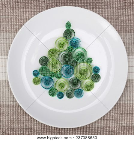 White plate with christmas tree. New Year concept.