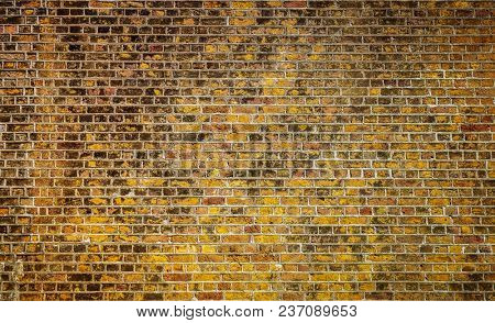 Very old brick wall with many colors of brick.