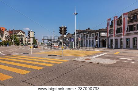Solothurn, Switzerland - 19 July, 2013: Traffic And Pedestrians On Hauptbahnhofplatz Square In The C