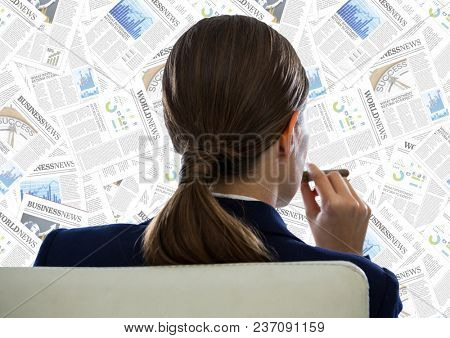 Back of business woman in chair looking at document backdrop