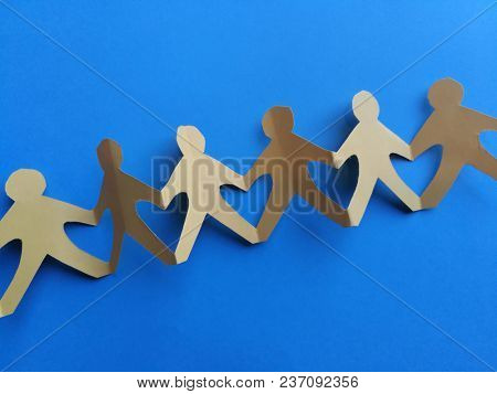 Paper people chain on blue background