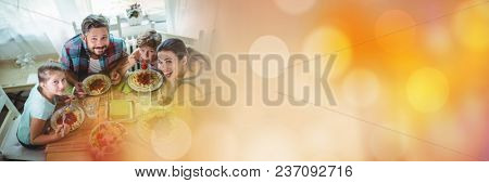 Overhead of family at table with orange bokeh transition