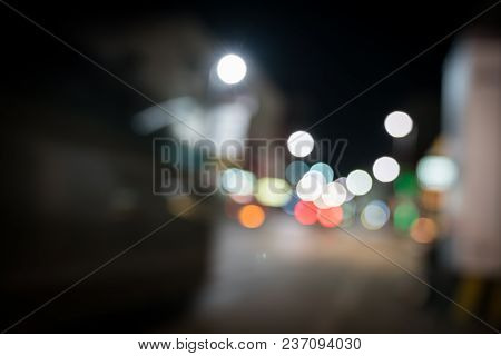 Bokeh Nighttime Street And Passing Vehicle Lights Abstract With Blur Creating Effect Of Motion In  C
