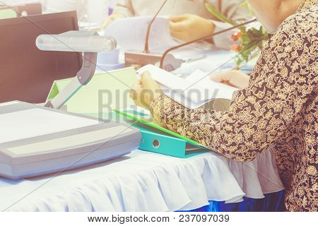 Hands Businessman Hold Papers On Table Present A Meeting Seminar And Opaque Projector With Copy Spac