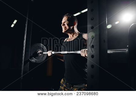 Close-up Of Male Athlete Preparing To Lift Barbell. Hands Lubricate Talc, Dust Around. Concept Worko